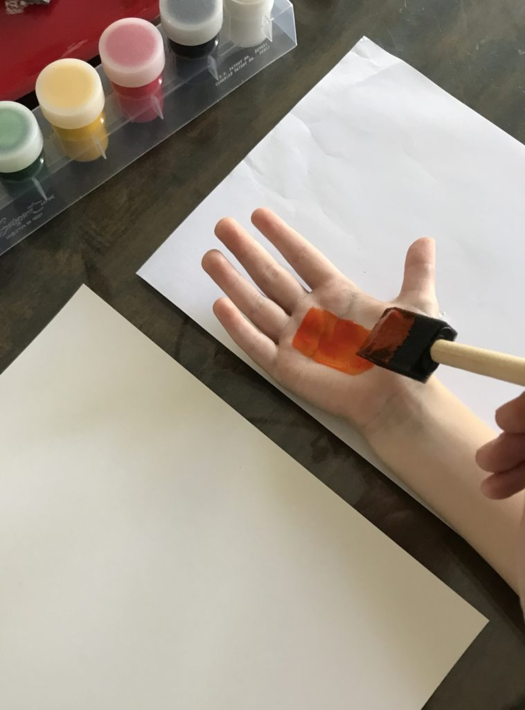 painting hand for handprint sign