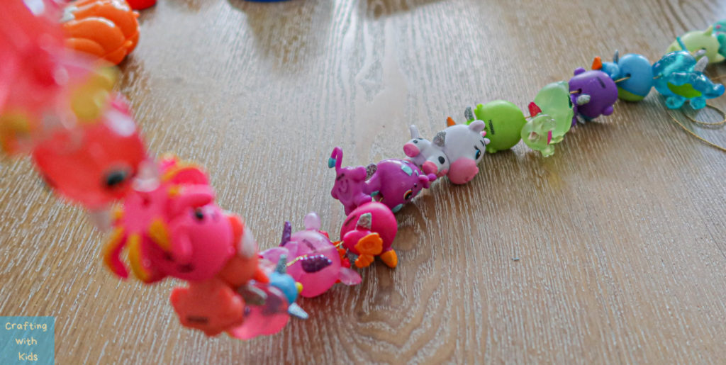 Stringing a collEGGtible Hatchimal necklace