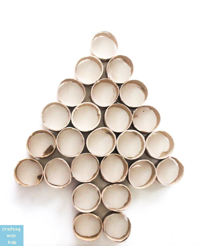 toilet paper rolls arranged in a Christmas tree