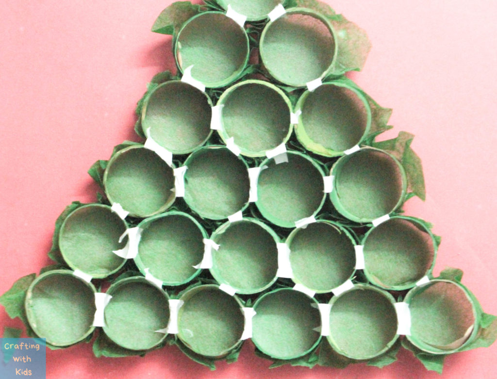taped toilet paper tubes in the shape of a Christmas tree
