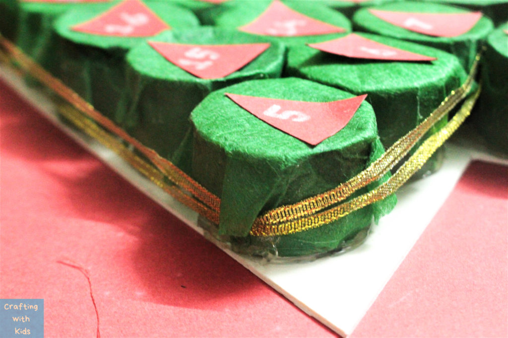 ribbon holding the advent calendar Christmas tree together