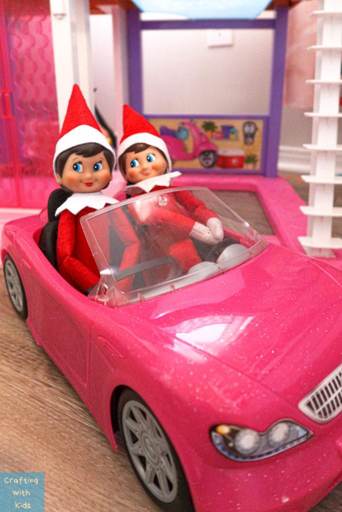 two Elf on the Shelf's in barbie car