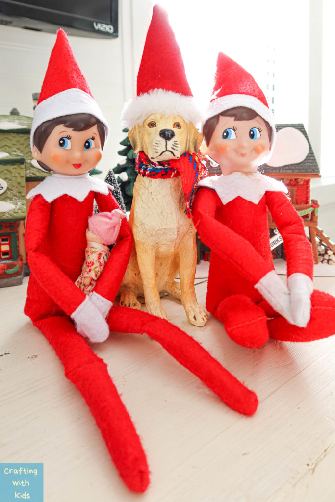 elf on the shelf family with dog and baby