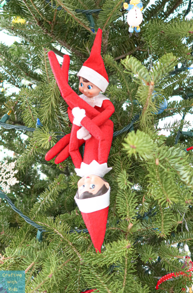 two elf on the shelf's playing in Christmas tree