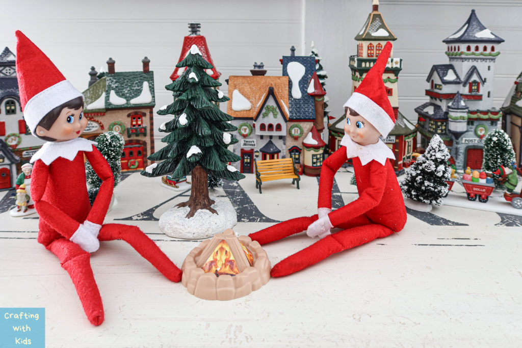 two elf on the shelf's by fire