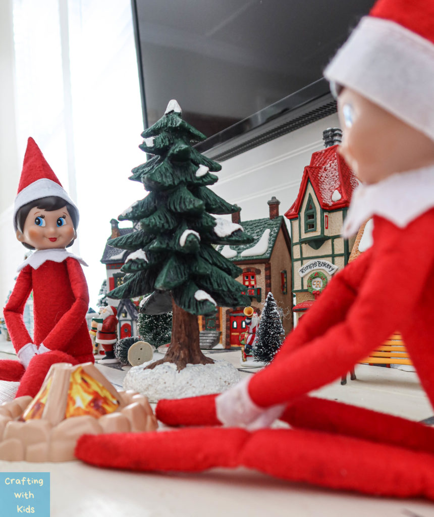 two elf on the shelf's by campfire