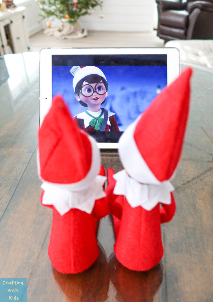 two elf on the shelf's watching a movie
