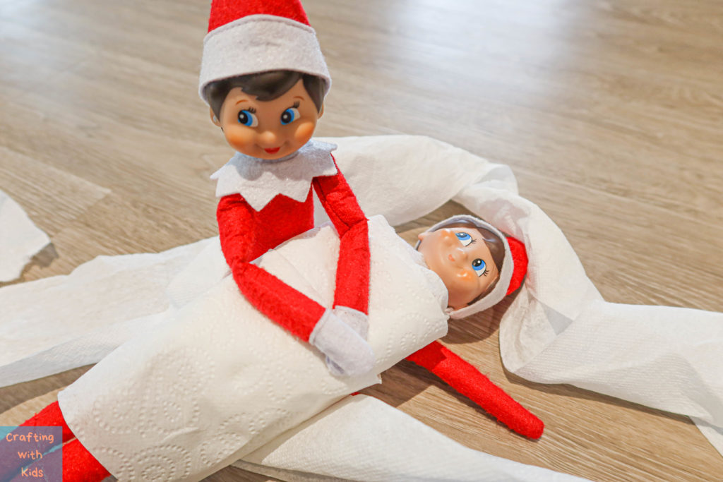 two elf on the shelf's wrapped in toilet paper