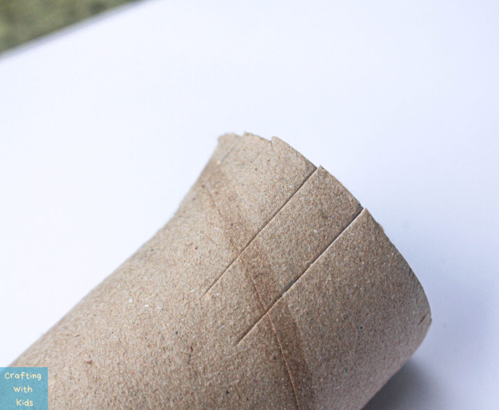 cutting toilet paper roll for 4th July craft