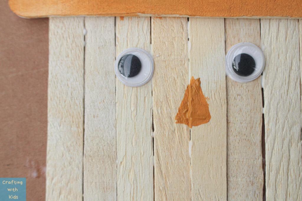 adding eyes to the scarecrow