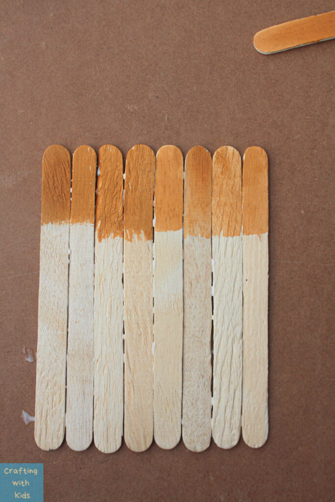 painting a popsicle stick scarecrow