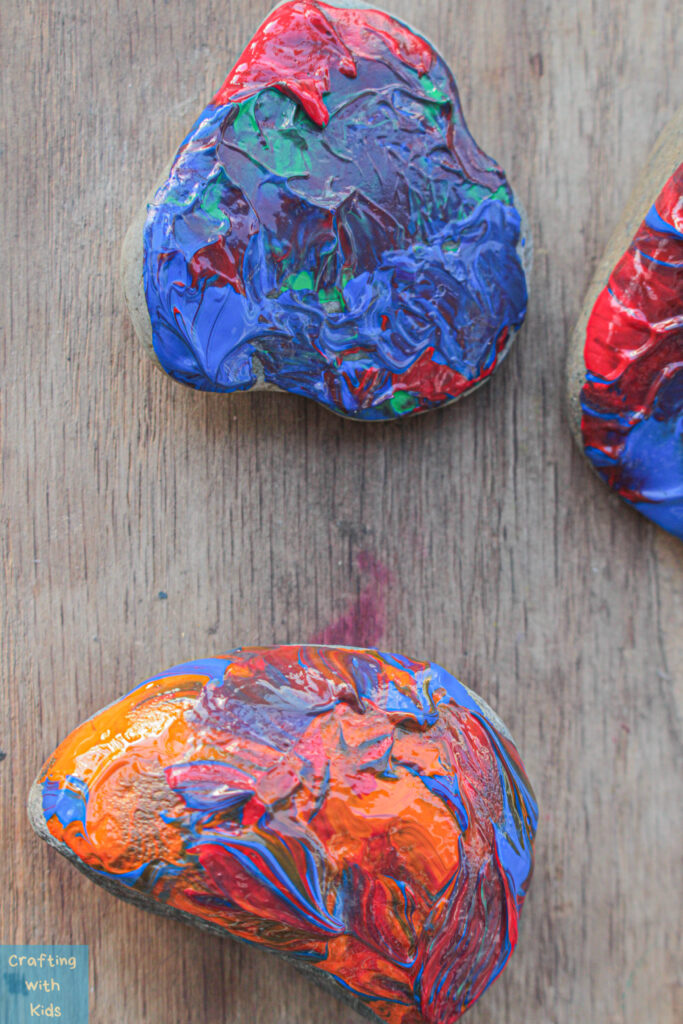 rock painting with acrylic dip paint technique