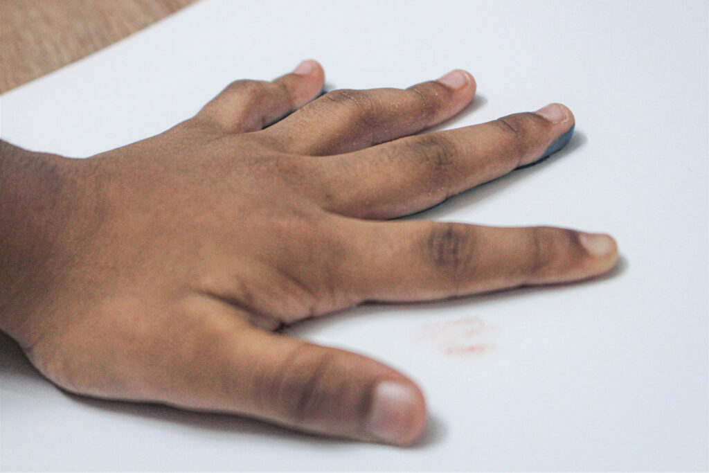 placing palm on sheet