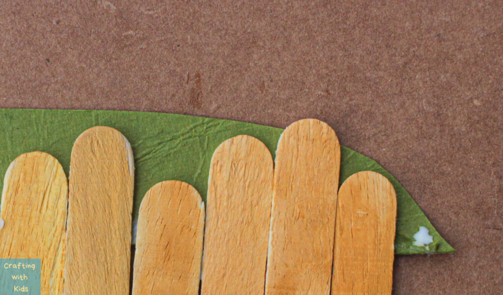 gluing paper on the back of sticks