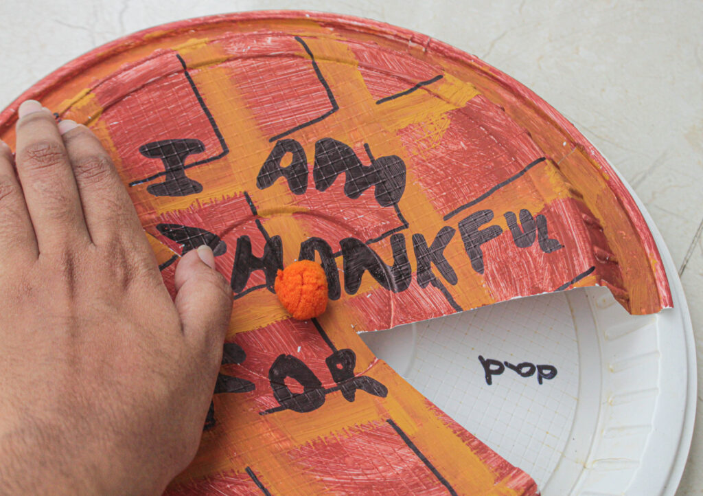 moving plate around for thankful Thanksgiving kid craft