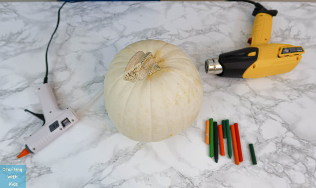 supplies for melted crayon art on pumpkin